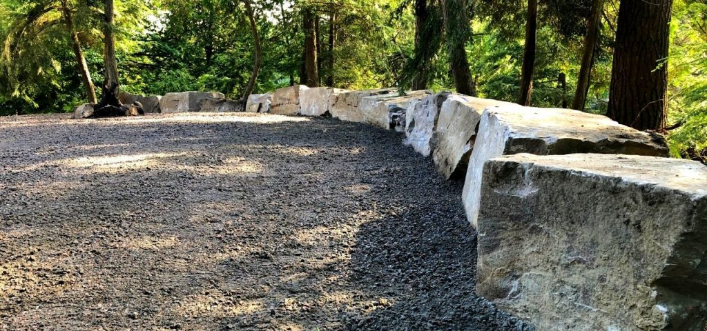 armour stone retaining wall and parking lot gravel